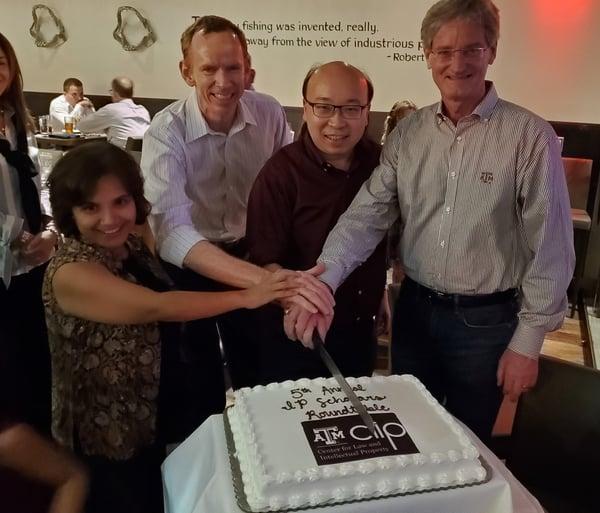 IP Roundtable cutting cake-1
